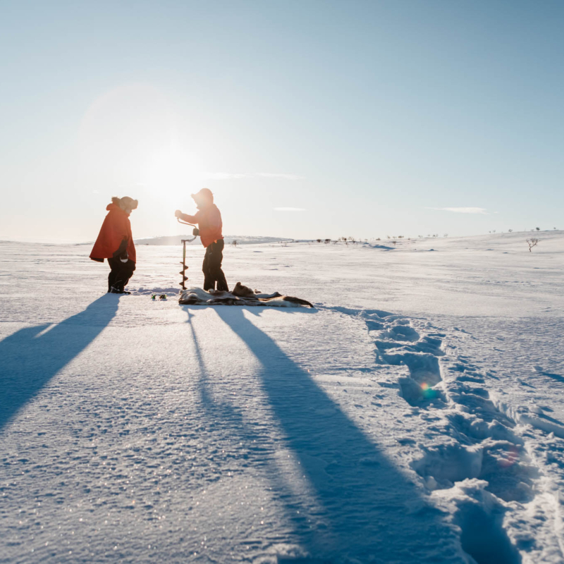 Ice fishing at a fell lake